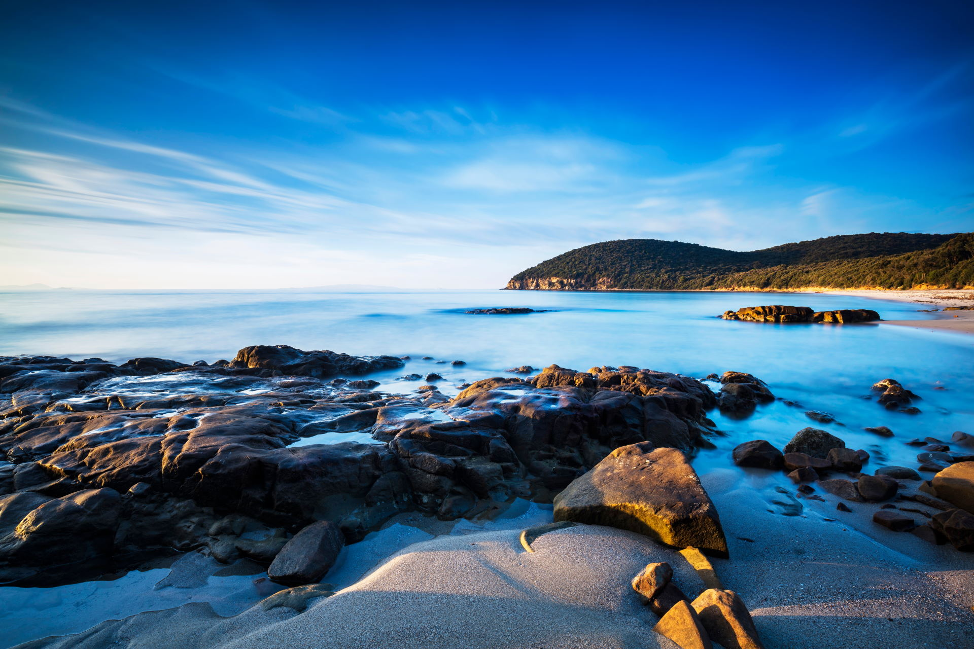 Sunset Cala Violina bay beach in Maremma, Tuscany. Travel destination in Mediterranean sea. Italy, Europe. Long Exposure.